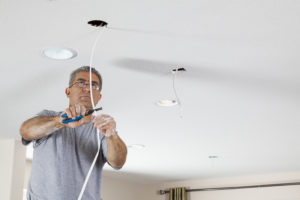 Electrician ceiling light installation.
